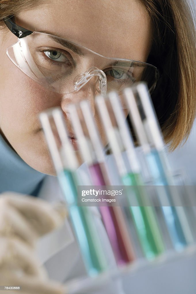 Scientist with test tubes : Stock Photo