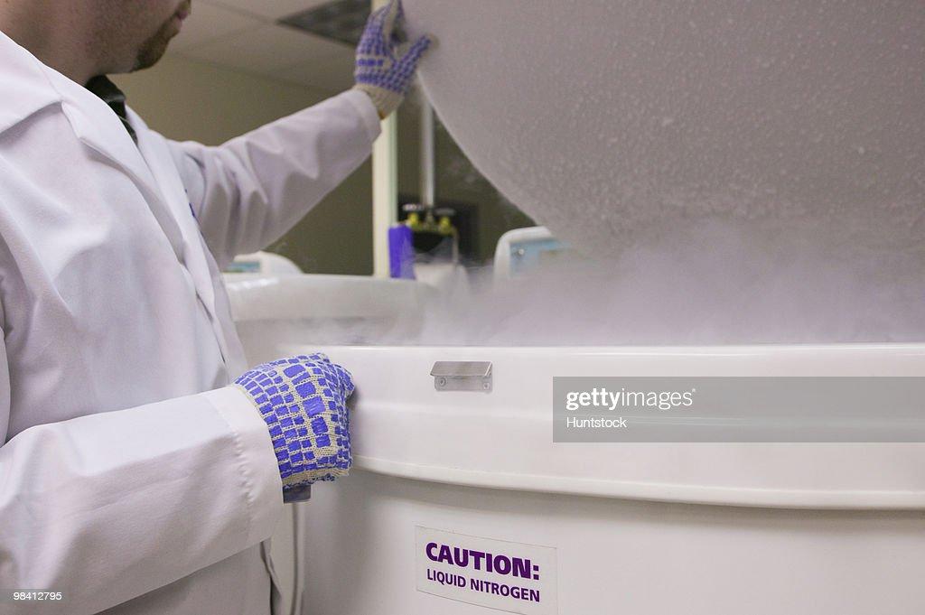 Scientist working on a liquid nitrogen container