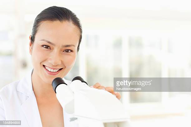 Scientist Working with a Microscope