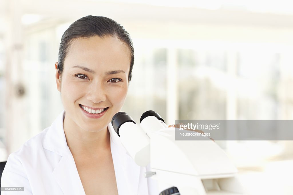 Scientist Working with a Microscope : Stock Photo
