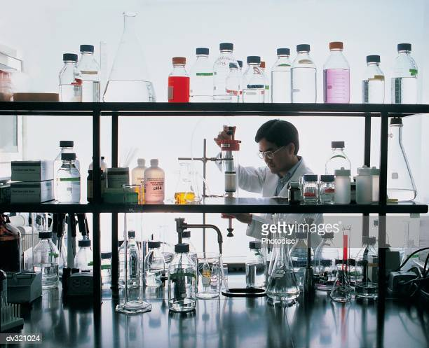 Scientist working with chemistry equipment