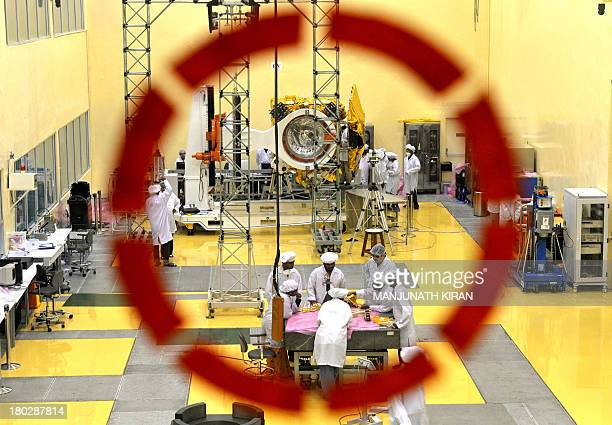Scientists and engineers work on a Mars Orbiter vehicle at the Indian Space Research Organisation's satellite centre in Bangalore on September 11...