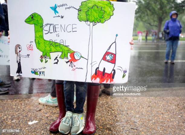 Scientists and supporters gather on the National Mall for the rally before the March for Science on April 22 2017 in Washington DC The event is being...