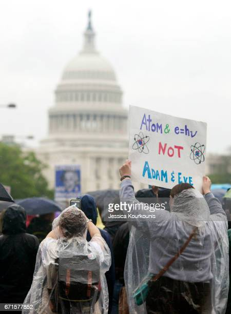 Scientists and supporters participate in a March for Science on April 22 2017 in Washington DC The event is being described as a call to support and...