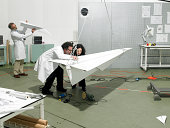 scientists constructing a plane in laboratory