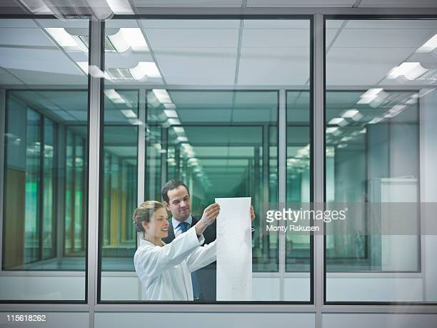 Scientists discuss plans in office