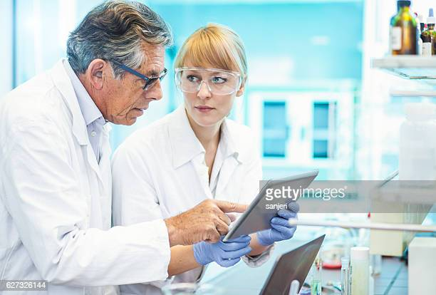 Scientists Discussing and  Using Computer Software