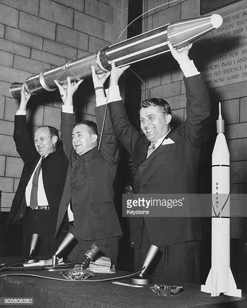 Scientists Dr William Pickering Dr James Van Allen and Dr Werner Von Baun of Iowa State University holding aloft a duplicate of the first American...