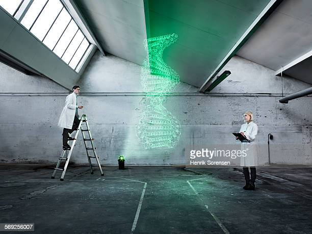 Scientists examining a holographic double helix