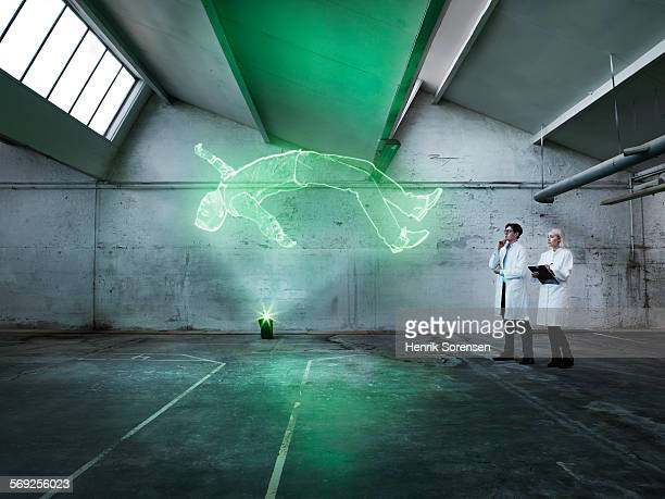 Scientists examining a holographic man