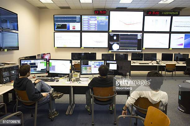 Scientists from the California Institute of Technology or Caltech observe data on displays in the control room of the Laser Interferometer...