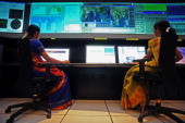 Scientists from the Indian Space Research Organisation work in the Indian Regional Navigational Satellite System control room at the Indian Deep...