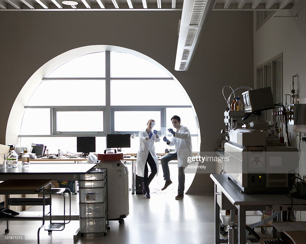 Scientists have discussion about DNA gels : Stock Photo