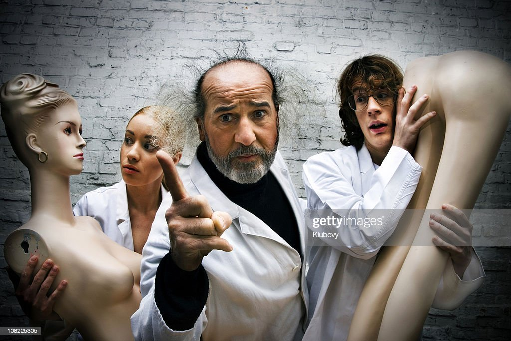 Scientists Holding Mannequins