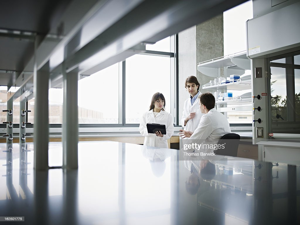 Scientists in research lab discussing project