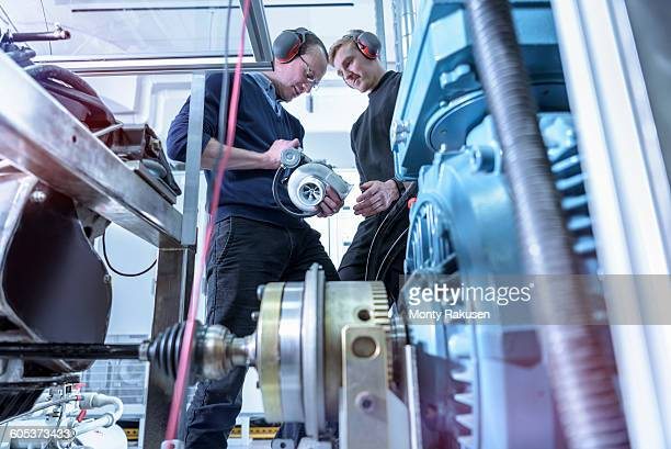 Scientists in turbo charger automotive research laboratory