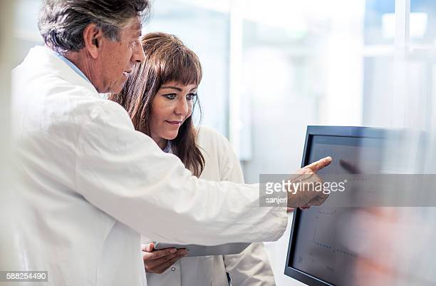 Scientists Interacting With the Computer Via Touch Screen