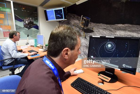 Scientists monitor with computers the trajectory and the first data transmitted by the robot Philae aboard the European Space Agency's cometchasing...