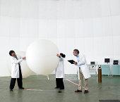 Scientists recording data in laboratory