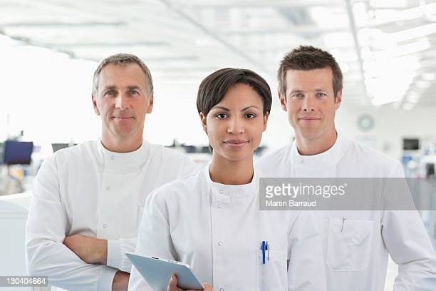 Scientists smiling in lab