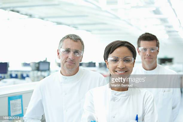 Scientists smiling together in lab
