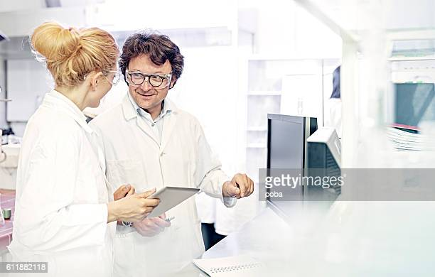 Scientists using digital technology in lab