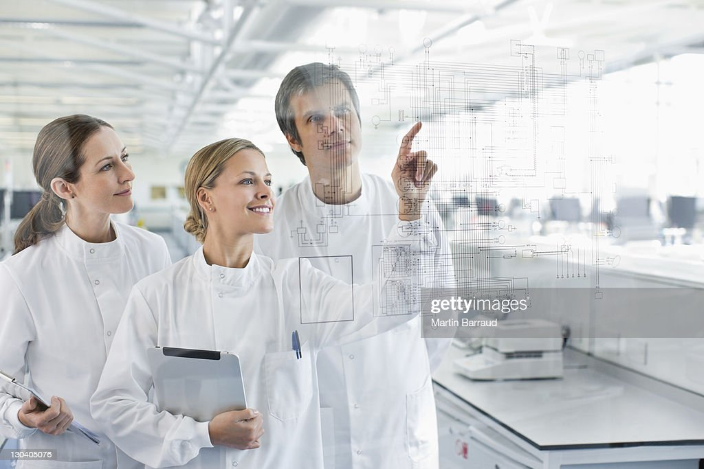 Scientists using touch screen in lab : Stock Photo