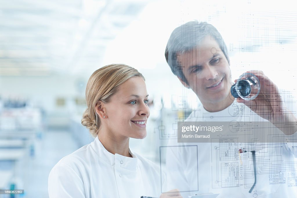Scientists using touch screen in lab