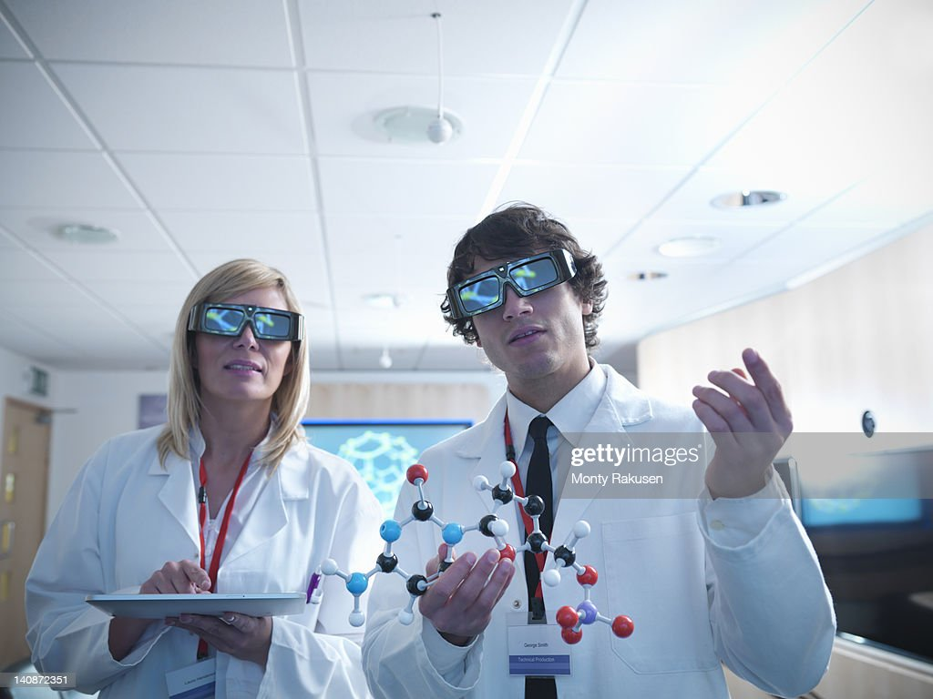 Scientists wearing 3D glasses in lab : Stock Photo