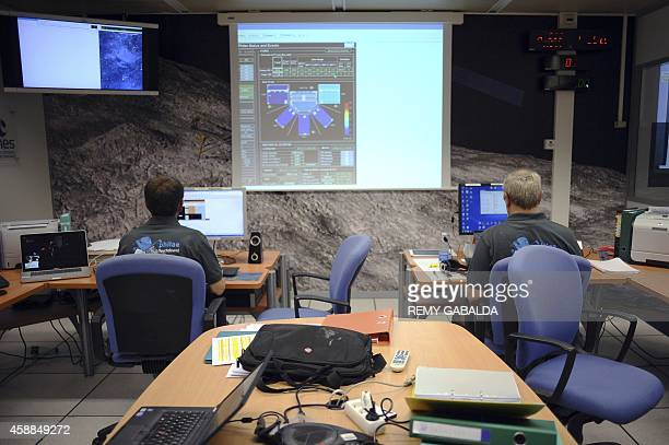 Scientists work in the scientific mission observation centre of the French space agency Centre National d'Etudes Spatiales in Toulouse southern...