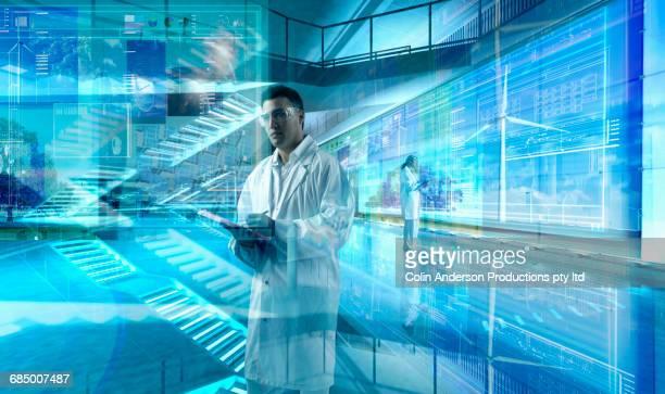 Scientists working in futuristic laboratory