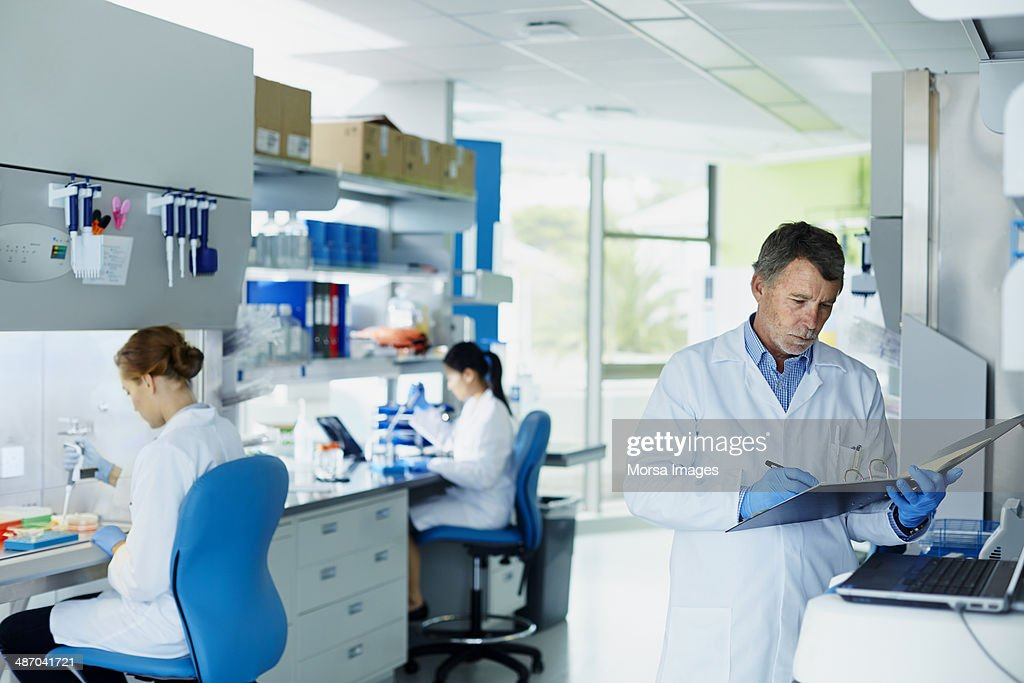 Scientists working in laboratory : Stock Photo