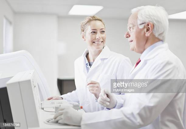 Scientists working in pathology lab