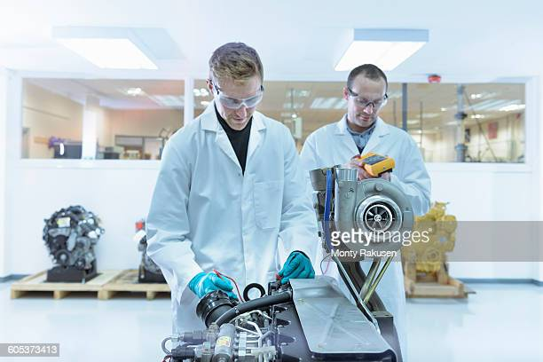 Scientists working in turbo charger automotive research laboratory