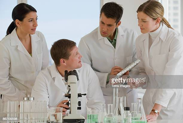 Scientists working together in pharmaceutical laboratory