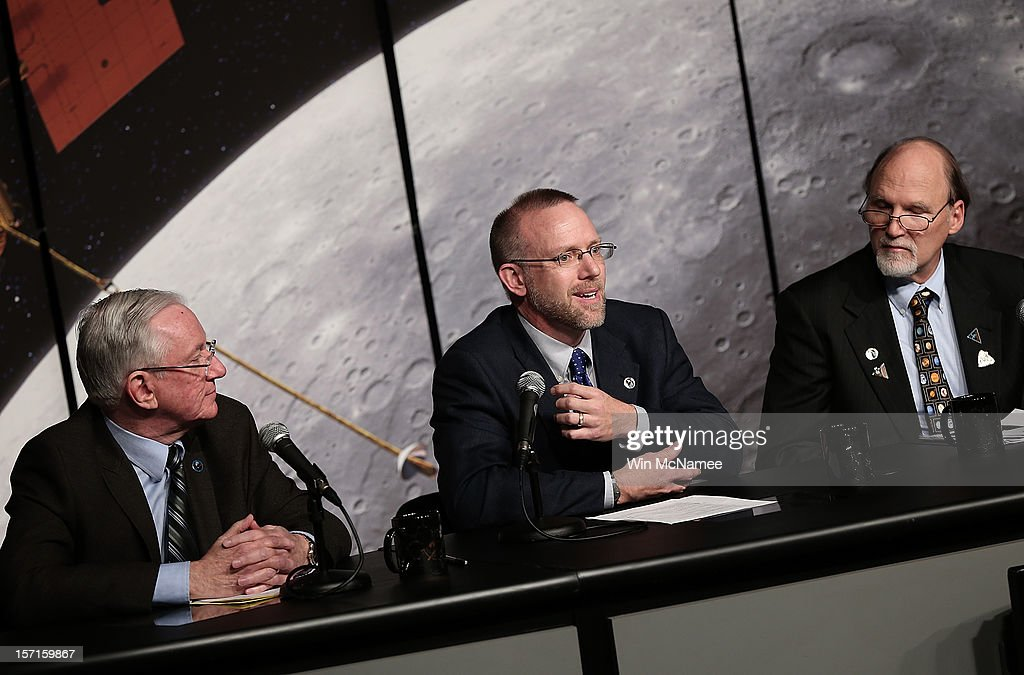 Scientists working with NASA's MESSENGER spacecraft program, (L to R) Sean Solomon, David Lawrence and Gregory Neumann, explain new findings during a press conference at NASA headquarters November 29, 2012 in Washington, DC. Recent studies performed by the spacecraft indicate support for a hypothesis that the planet Mercury planet harbors abundant water ice and other frozen materials within its shadowed polar craters.