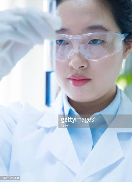 Scientists working with Test Tube