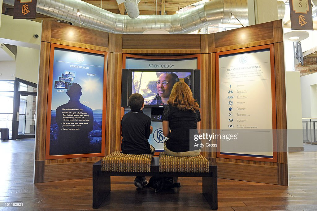 Scientologists Ali Pruitt right and her son Turner view material at the new Church of Scientology of Denver building in the 'public information...