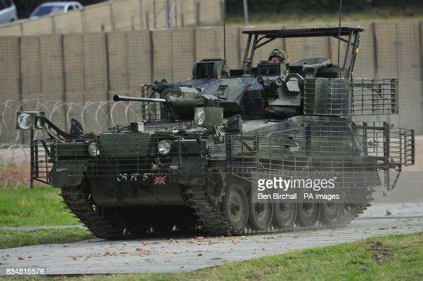 A Scimitar tank with added body armour in the form of heavy duty metal grids that cause antitank weapons to detonate further from the body of the...