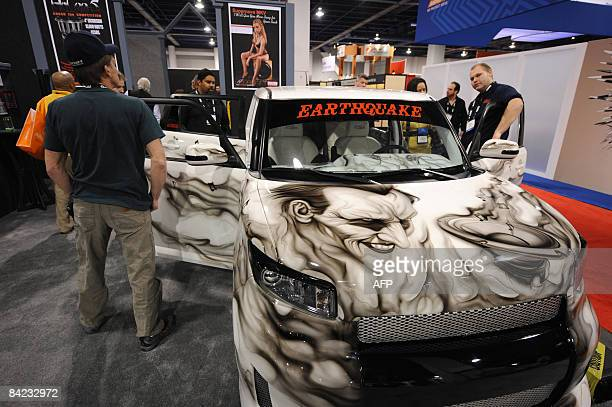 Scion XB with a custom paint job featuring the late actor Heath Ledger as the Joker in 'The Dark Knight' and outfitted with Earthquake audio speakers...