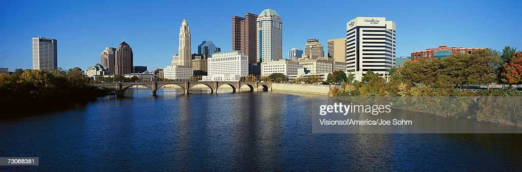 'Scioto River and Columbus Ohio skyline, with setting sunlight'