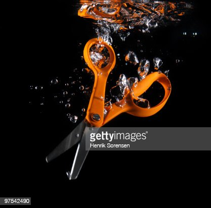 Scissors and bubbles in water : Stock Photo