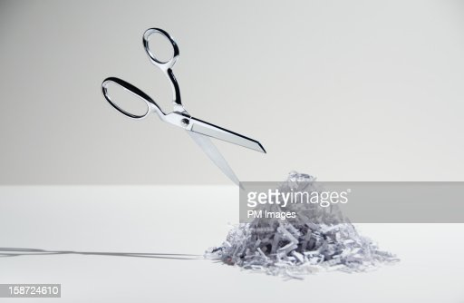 Scissors and shredded paper : Stock Photo