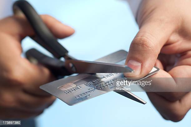 Scissors cutting a credit card