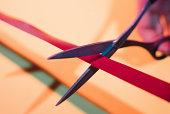 Scissors cutting a ribbon