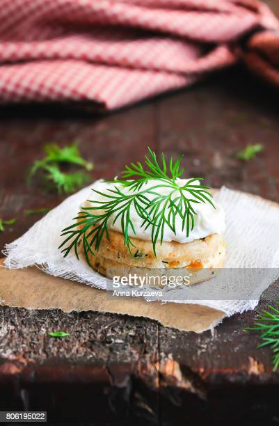 Scone with carrot and dill garnished with cream cheese, selective focus
