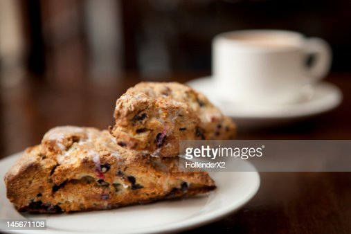 scones and coffee on table : Stock Photo