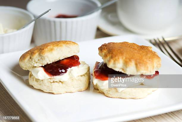 Scones with cream and jam served with tea