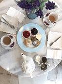 Top view, hot, tea, with milk, jar,tea break,marble,scone