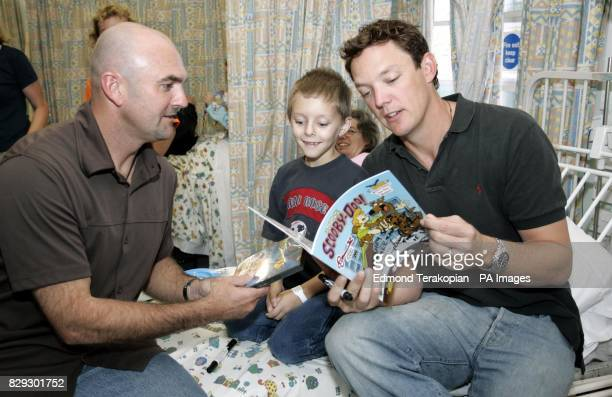 Scooby Doo 2 stars Matthew Lillard and Neil Fanning the voice of Scooby meet nine yearold Jason Granby from Ilford in Essex during a visit to Great...